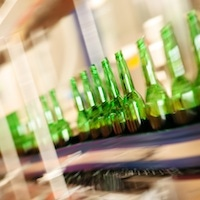 Empty bottles on factory conveyor belt (long exposure)