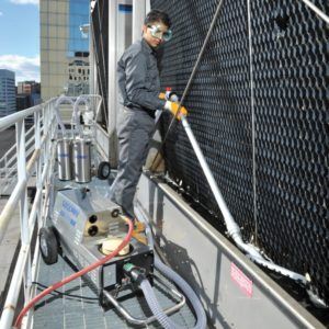 How Clean-in-Place Cooling Tower Solutions Reduce Hassle, Cost and Liability